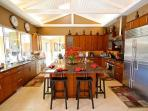 Sunny, gourmet kitchen with modern amenities