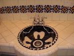 Cobalt blue decorative sink and talavera tiles in front bathroom