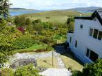Side of apartment and view down the garden to the Sound of Raasay from the seating area