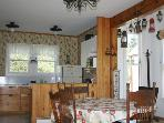 The heart of the house is this lovely bright eat in kitchen. Complete with antique hutch, dining table and all the...