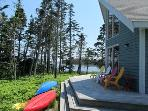 Shielded behind a stand of spruce trees, Ragged Island Retreat is a private getaway.