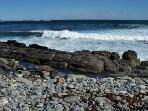 waves crash upon the shore