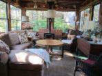 With a patio in front, this comfortable Sun Room has windows all around. A propane fireplace keeps the room cozy on...