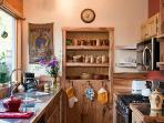 Kitchen with homemade pottery and stainless steel countertops