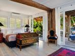 Sleep in luxury king ensemble bedroom opening onto large deck