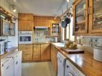The kitchen is a modern extension with dish and clothes washer, drier, fridge, freeze, micro wave