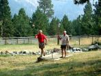 Playing horse shoes in the front yard