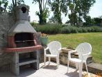 The outdoor BBQ, the pool is above surrounded by sweet smelling lavender.