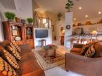 Living room with large screen TV wall mounted, DVD player, includes pullout couch if required