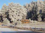 Cabin on a crystal clear frosty morn