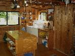 Kitchen showing washer and drier. Linen closet.