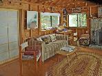 Living room with sofa bed. Shoji doors closed