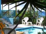 The rock garden is behind the pool as we look out to sea. This view shows the Camino Islands, Tortola , The Dogs, etc.