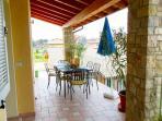Lovely terrace overlooking pool for al fresco dining!
