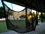 Enjoy sunsets from the chair in the air on the Pearl Shack deck.