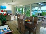 The open plan dining/lounge area captures specatcular Moreton Bay views