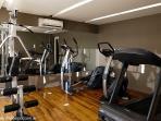 Gym with Elliptical Machine, Treadmill, Bike, and Free Weights
