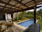 The pool area comes with uniquely designe chaise lounges, comfotable seating, and charcoal/gas BBQ