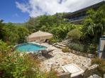 Spacious poolside deck with views of the mountain behind at Sunset Watch Poolside Villa.