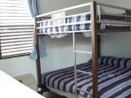 Second bedroom top and bottom full size bunk beds.