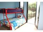 Surf's Up!Kids Room in the Main house.  Has a Twin/Full bunk bed and dressers.