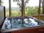 Relax in this hot tub while looking out for miles into the mountains