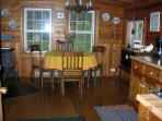 Comfortable seating for 4-5 people in kitchen or there is also an outside picnic table and gas grill