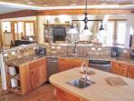 Beautiful fully stocked gourmet kitchen.  Perfect spot to entertain