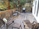 Outside deck with summer chairs and grill to enjoy.