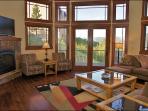 Living Room # 1 showing HDTV, Fireplace & Deck