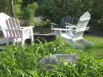 Front gardens with adirondack chairs