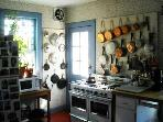 country Quimper kitchen, French copper pots