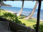 The cottage lanai is right on the beautiful blue ocean.