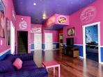 One of several open area rooms - the 'bubble gum parlor'..More photos: www.sweetescapehouse.com