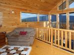 Loft Sitting Area with Love Seat, and a 25 mile view of the Smoky Mountains and Wears Valley
