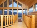 Catwalk in Loft Bedroom leading to the upper deck where you can enjoy beautiful valley and mtn view!