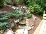 Landscaped Waterfall with 5 Falls. Deck with Stacked Stone Gas Fire Pit and 25 Mile mountain View.
