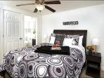 Queen Tempur-Pedic Mattress, Private Bath, and a Flat-Screen TV in the Master Bedroom
