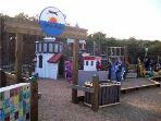 Puma Park Behind The Library/Community Ctr, the coolest park for kids is free! Rock wall too!
