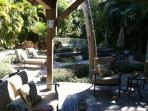 View of back yard and new patio furniture.Taken in the afternoon. Quite sunny throughout day!