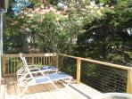 private deck with Mimosa flowering tree