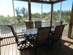 Screened in porch with table for 6 !
