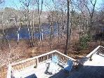 The rear deck in the Fall overlooking the pond
