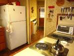 The kitchen has a tiled island w/ electric range, laundry room has washer/dryer, breezeway entrance.