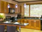 Kitchen with Breakfast Bar and Open to Great Room