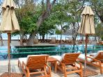 Private Playa Prieta Beach Club Lap Pool with view of day beds and lounge chairs on Prieta beach