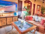 Living room features comfy Caribbean Hemingway furniture