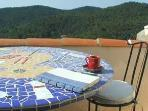 Rooftop terrace with mosaic table