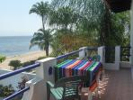 Large balcony for both upstairs suites looking over the pool and ocean
