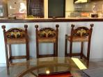 New hand-carved bar stools are very comfortable and add to the Mexican design